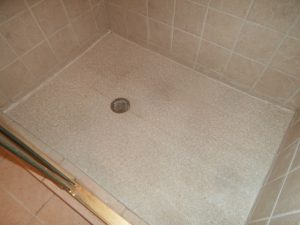 Shower with linoleum flooring